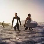 guys_surfing_kids_in_background_wecreate