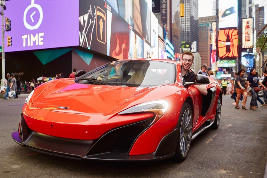 The joy on my face in this picture so perfectly exemplifies why I want to—no, must—buy a McLaren.