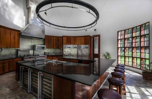 12 Chefs kitchen with triple-height ceiling