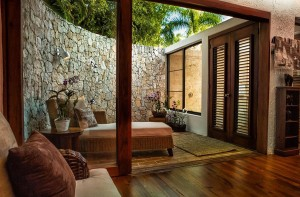 19 This outdoor shower is tucked into coral walls for privacy