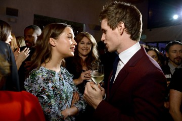WEST HOLLYWOOD, CA - FEBRUARY 26:  Actors Alicia Vikander (L) and Eddie Redmayne attend the Film is GREAT Reception at Fig & Olive on February 26, 2016 in West Hollywood, California.  (Photo by Michael Kovac/Getty Images for The GREAT Britain Campaign)