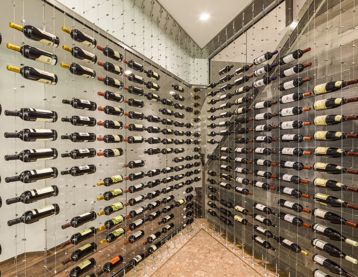the cable wine system® adds sophistication and flair to any wine  - cable wine system custom wine cellar by papro consulting fork
