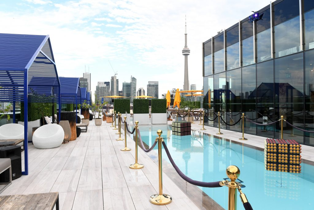 "TORONTO, ON - SEPTEMBER 09: Pool and lounge area at the official pre-party for ""Snowden"" co-hosted by Audi and Nespresso at Lavelle on September 9, 2016 in Toronto, Canada. (Photo by Sonia Recchia/Getty Images for The Mint Agency)"