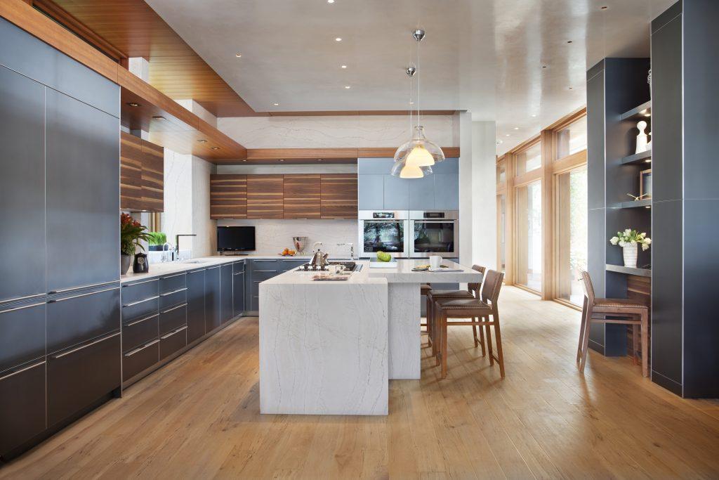 Waterfall-edge kitchen island featuring Ella™ design.