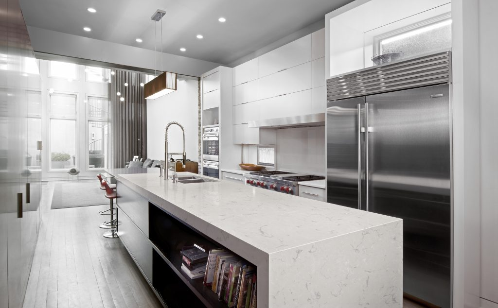 Sleek, modern kitchen featuring Swanbridge™ design.