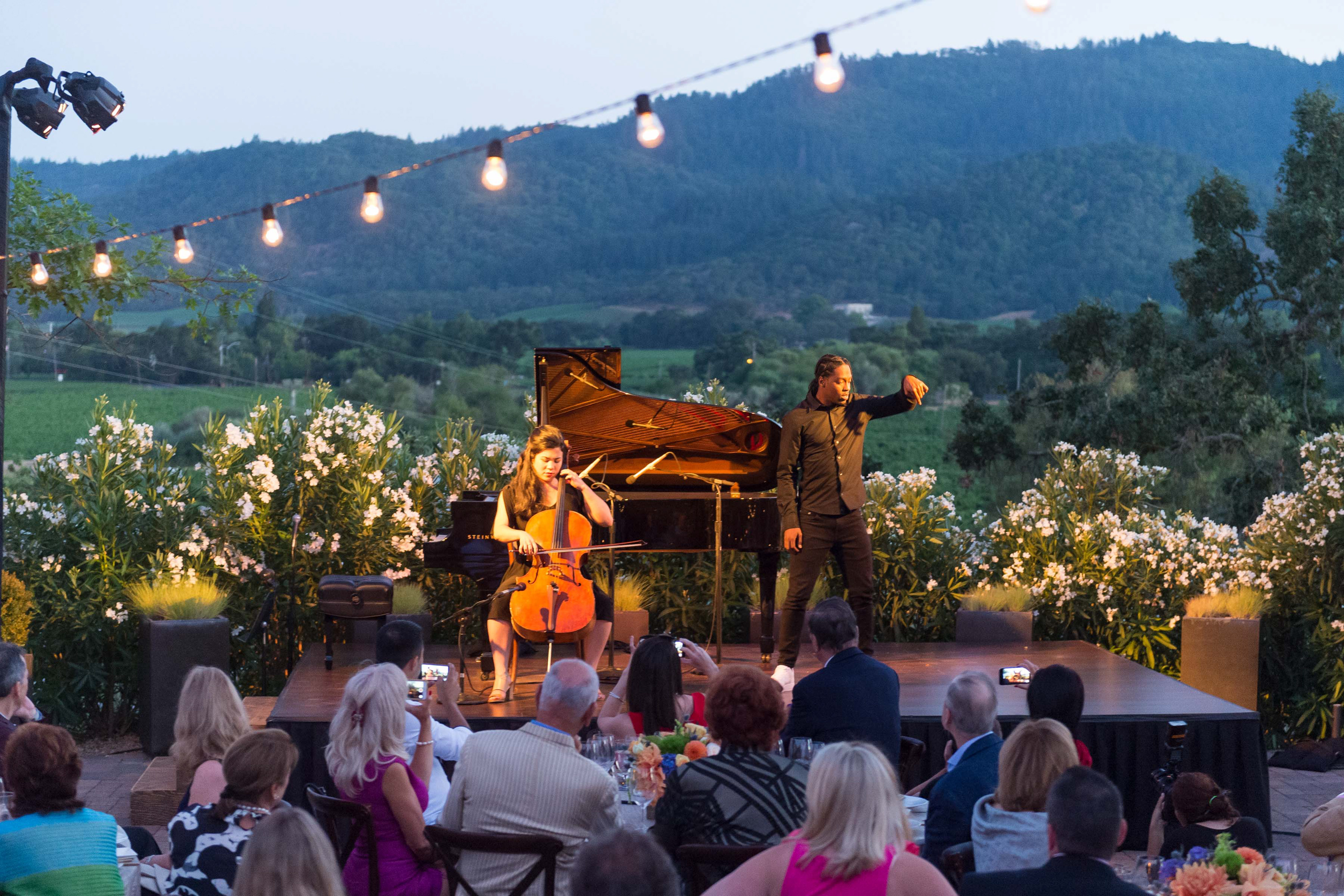 OAKVILLE, CA - July 14 - Mariko Wyrick and Ron Primetyme Miles attend Festival Napa Valley Founders Dinner at Cardinale Winery July 14th 2016 at Cardinale Winery, . 7600 St Helena Hwy in Oakville, CA (Photo Credit: Susana Bates for Drew Altizer Photography for Drew Altizer Photography)