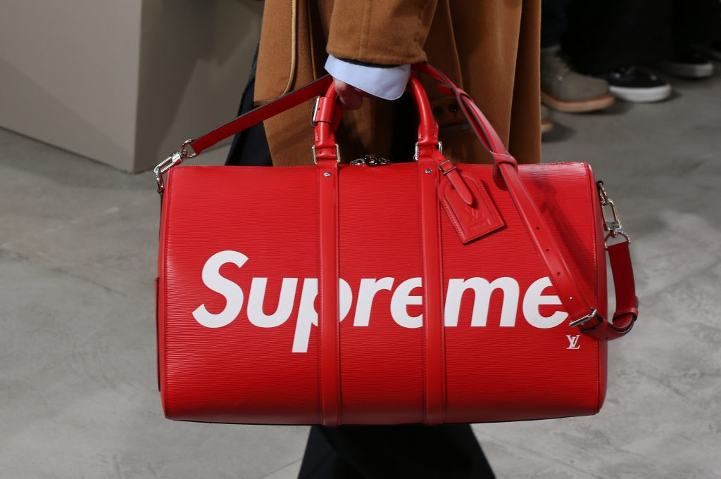 954abeb2e6e5 ... logo from the bag and let the bright red of the collaboration speak for  both brands. If there were one piece from this collection that was an  undeniable ...