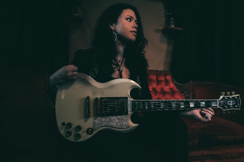 Liz Brasher with Gibson SG Custom at the Gibson Showroom. Credit: Ryan Vestil.