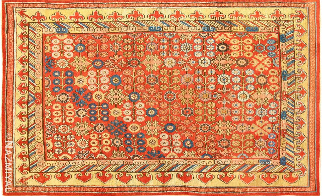 Small Antique Red Background Khotan Rug